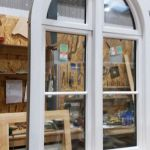 Arched wood window